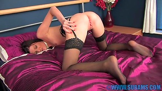 Scheming brunette Ellidh in stockings and lingerie bringing off on the bed
