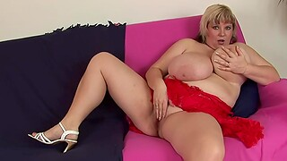 Chubby slattern Juliana B. moans greatest extent playing with a red fuck toy
