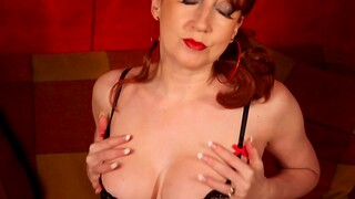 Red XXX plays with her soaking wet pussy